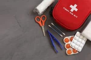 Image of a first aid kid on a grey backgground